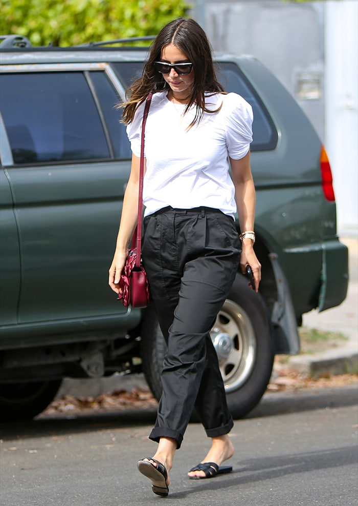 Ana de Armas styles her outfit with a Valentino sling bag, Celine sunglasses, and her favorite Cartier bangle and watch