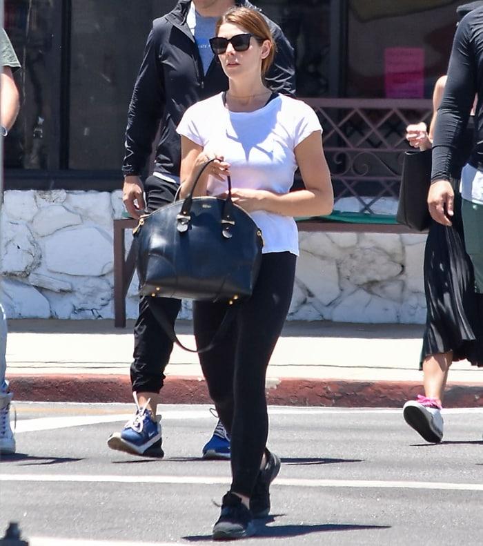 Ashley Greene carries an Alexander McQueen Legend calfskin satchel with golden hardware