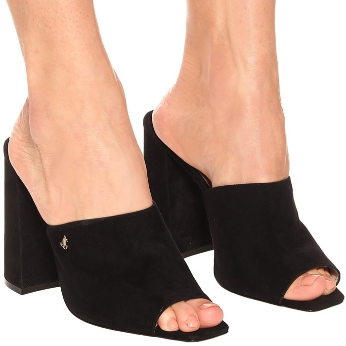 Made in Italy from wear-with-anything black suede, they have a square open toe and a tall block heel – which creates a leg-lengthening effect, but is also comfortable to wear