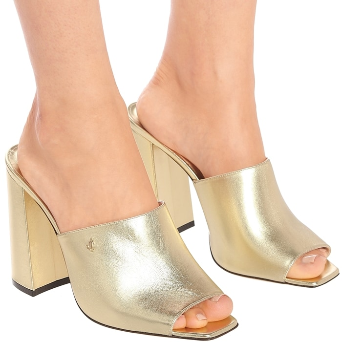 Made in Italy from leather in a look-at-me golden hue, they have wide straps and square open toes