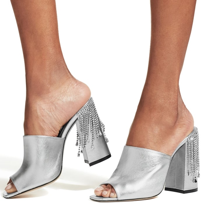 Presented in silver-tone leather, this shiny pair is embellished with crystal fringing to the rear of the high block heel