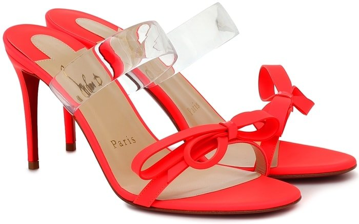 This bright-red pair is made in Italy from matte leather with clear PVC straps crossing the uppers