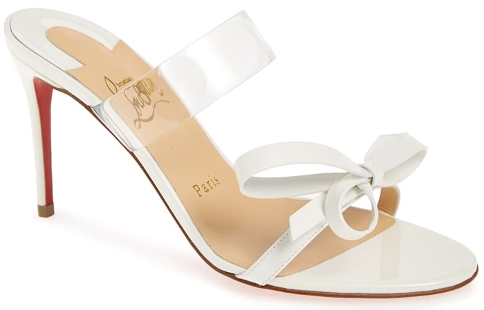 A transparent strap and dainty bow intensify the modern sophistication of this impeccably poised sandal