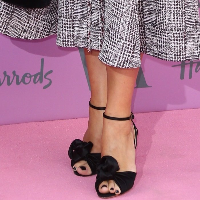 Charlotte Olympia Dellal shows off her feet in black sandals from her eponymous footwear label
