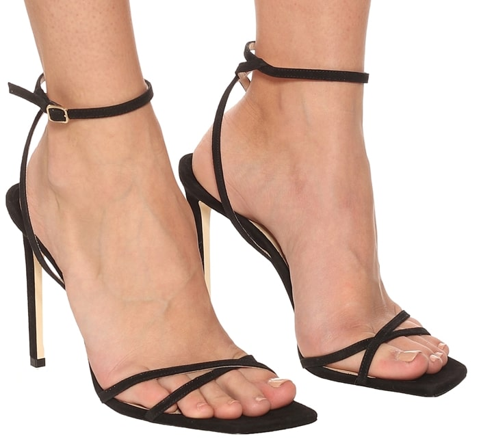 Made from classic black suede, it has crossing bands at the toes, as well as a thin ankle strap with buckle fastening