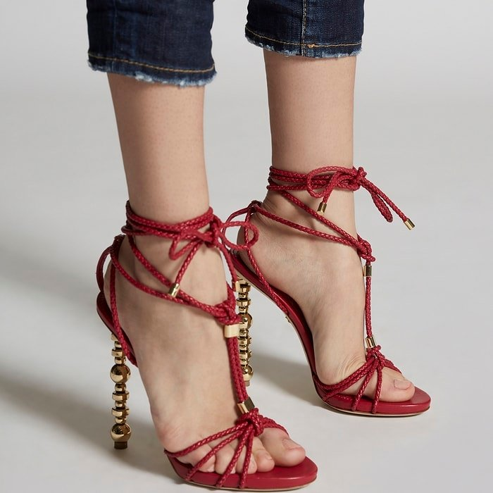 Red strappy high heel sandals from DSQUARED2 featuring a woven leather effect, gold-tone hardware, a knot detail and carved gold-tone high heels