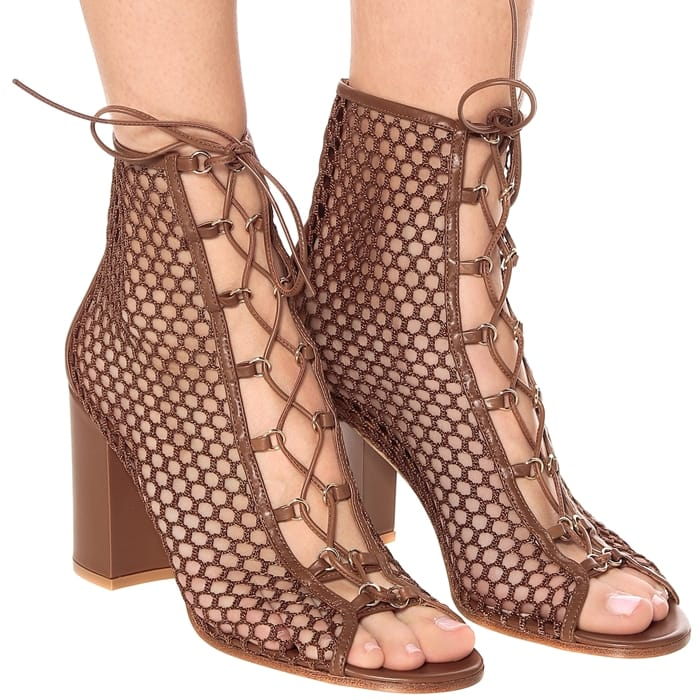 These fishnet-like mesh booties are trimmed with leather and set on chunky block heels