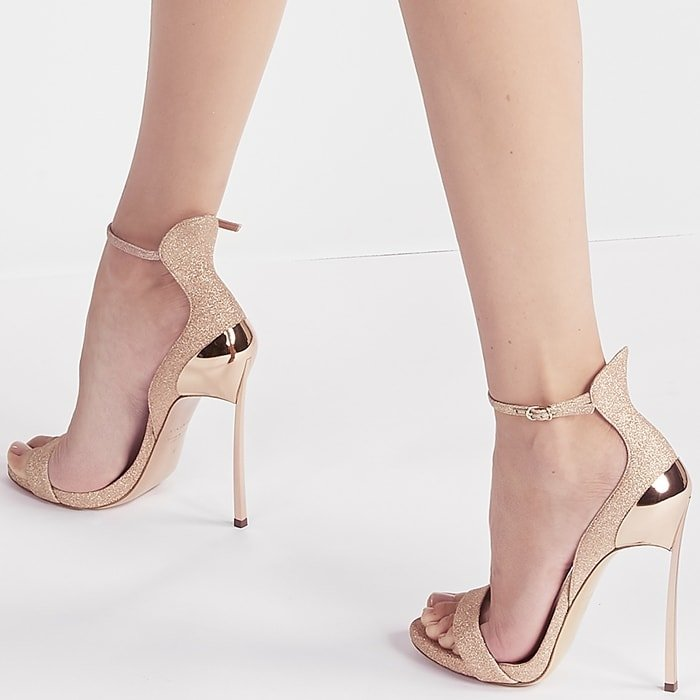 The thin ankle strap and the iconic heel will elongate the leg