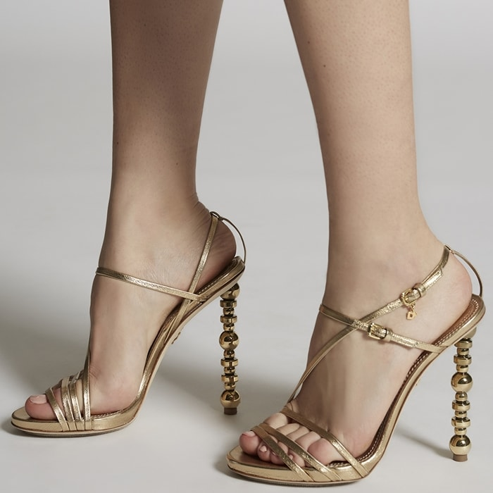 Made from smooth goat skin, this pair sits on a metal-embellished stiletto heel add will add a sense of effortless femininity to any look