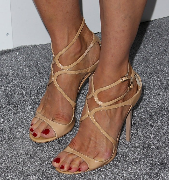Jenna Elfman's pedicured big feet