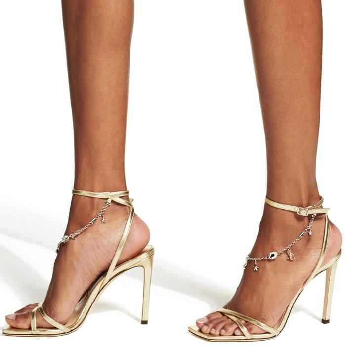 Jimmy Choo's new season Metz 100mm sandals have been designed with a delicate star and logo charm anklet to reignite all your memories from childhood
