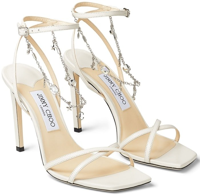 This latte nappa leather pair is embellished with a draping JC-chain, complete with star charms for a distinctive touch