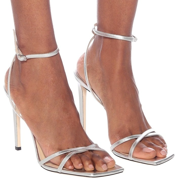 Made from silver-tone nappa leather, they have crossing bands at the toes, as well as thin ankle straps with buckle fastening