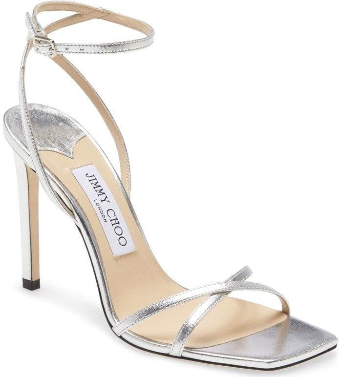 Ready for the red carpet, this minimalist ankle-strap sandal becomes a major showstopper with a squared-off toe and metallic leather