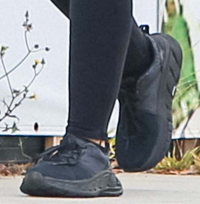 Katherine Schwarzenegger in Hoka One One running shoes