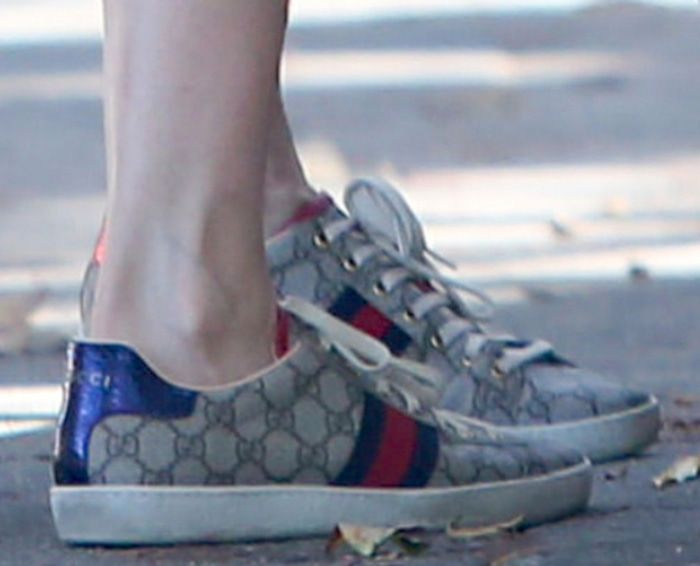 The classic GG Supreme logo shines through on Laura Dern's sneakers featuring web stripes at the sides and genuine snakeskin heel counters in house colors