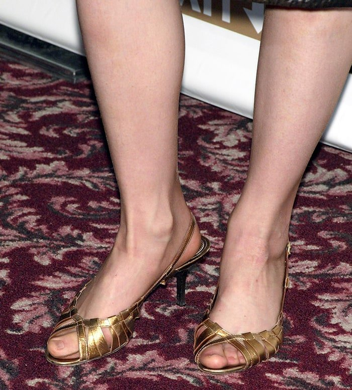 Lauren Ambrose's big feet in gold slingback peep-toe pumps