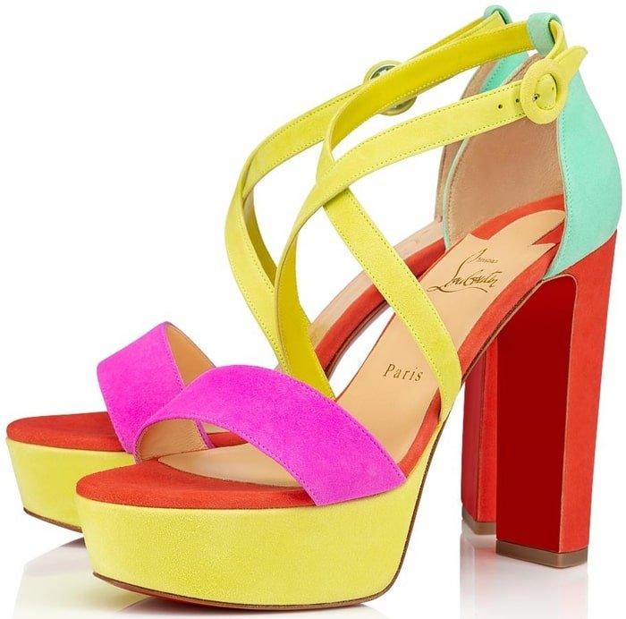 Crisscrossing straps are secured with a circular wrapped buckle on a playfully glamorous platform sandal lifted skyward on a major heel