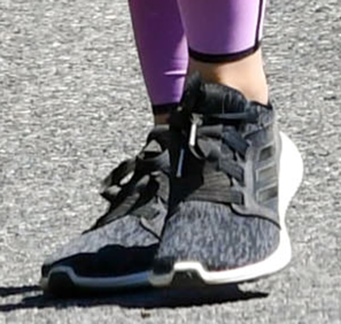 Lucy Hale completes her sporty look with Adidas shoes