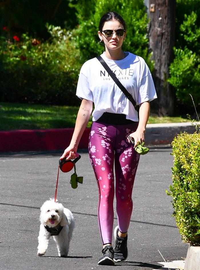 Lucy Hale walks her dog, Elvis, around her neighborhood in Los Angeles on June 7, 2020