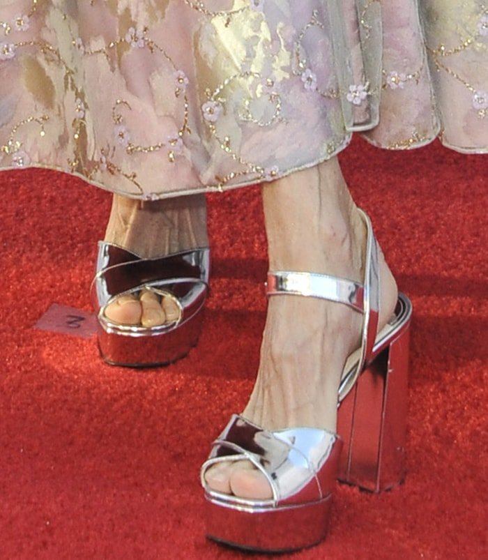 Meg Ryan wears silver platform heels for her size 11 feet