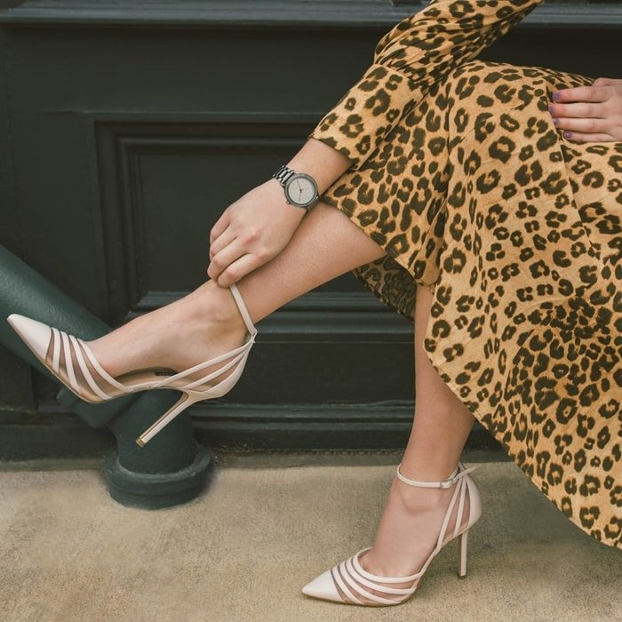 Nine West's Beck two-piece pumps pair translucent flair with trim strips atop skinny stilettos