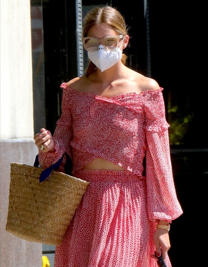 Olivia Palermo wore a white face mask and Westward Leaning sunglasses