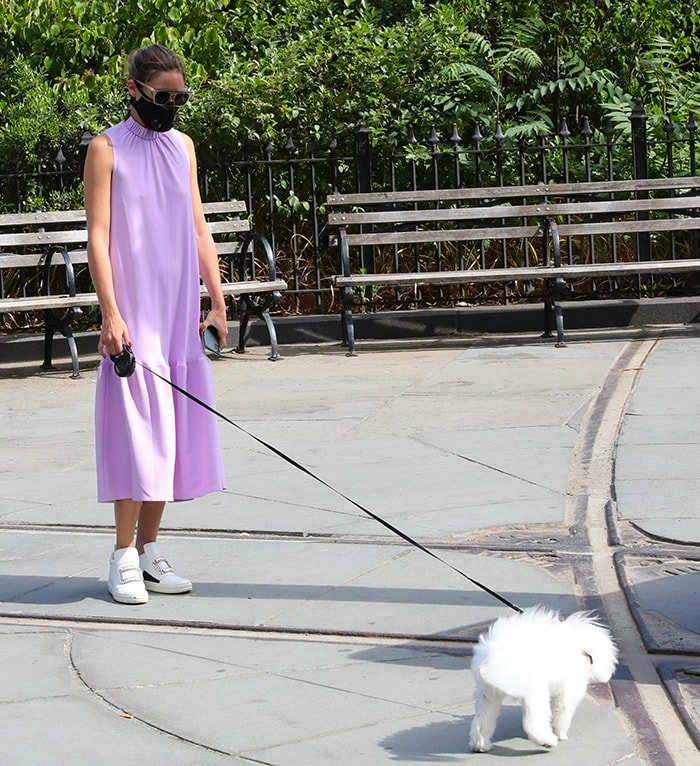 Olivia Palermo goes braless in a Tibi lavender dress as she walks her dog, Mr. Butler, in New York City on June 25, 2020