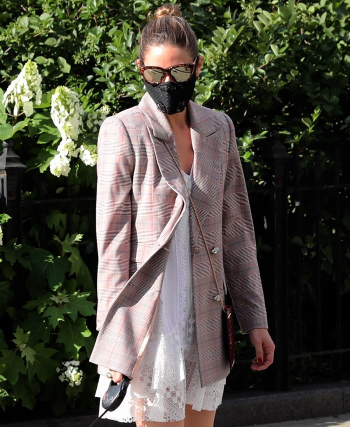 The cat-eye frame of Olivia Palermo's Le Specs sunglasses adds a touch of style