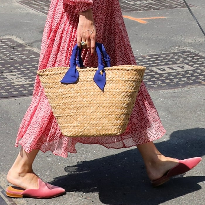 Olivia Palermo opted for pink velvet mules from Le Monde Beryl, a luxury shoes, accessories, and jewelry brand based in London and founded by friends Lily Atherton Hanbury and Katya Shyfrin