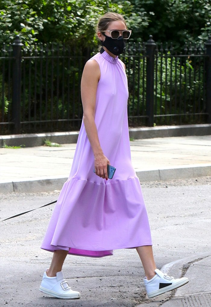 Olivia Palermo teams her lavender midi dress with white high-top sneakers