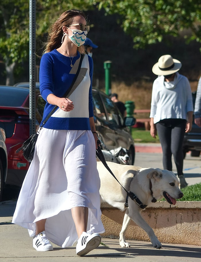 Olivia Wilde goes for a summery look in a blue sweater and white maxi skirt