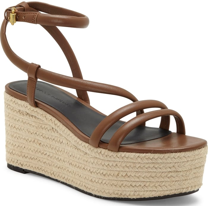 An espadrille-inspired platform wedge grounds this strappy sandal in earthy yet refined style