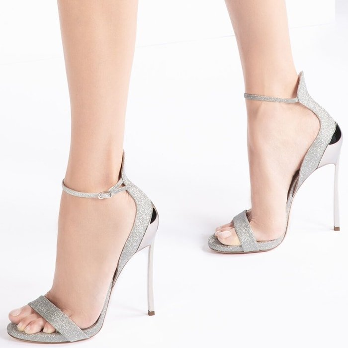 With a dainty ankle strap and the signature heel to elongate the leg, this silver pair lend themselves perfectly to evening events