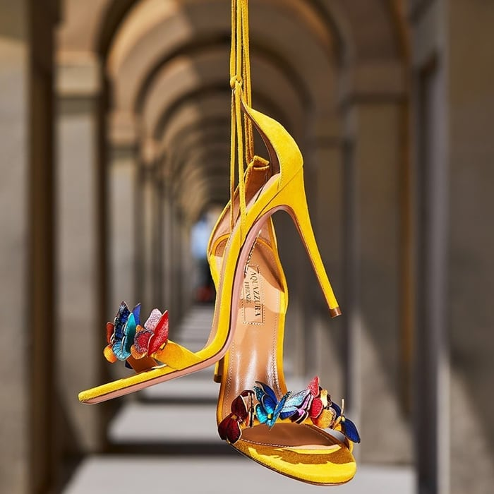 This yellow sandal is highlighted by colorful butterflies emblazoned at the toe and at the side and features slim straps that wrap around the ankle