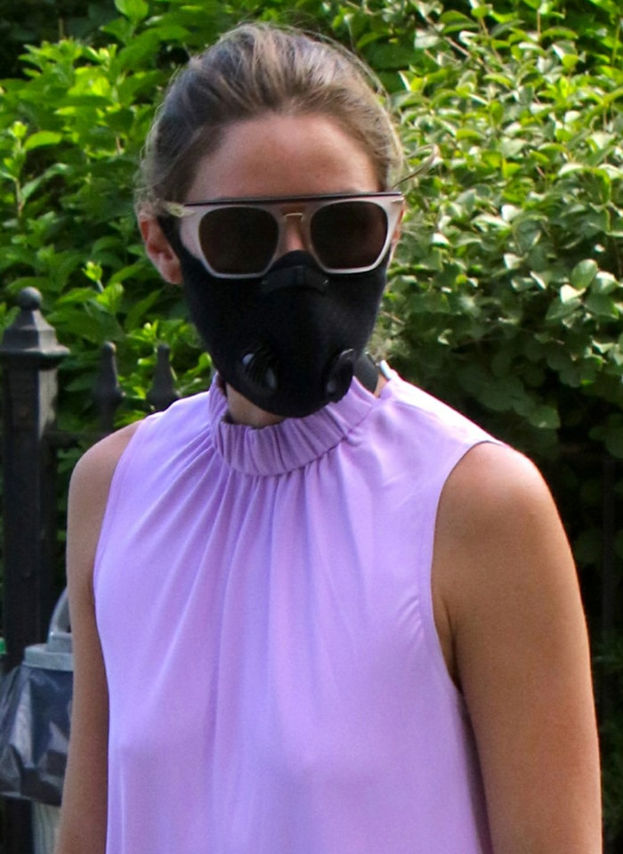 Olivia Palermo wears a black face mask and a pair of Westward Leaning sunglasses