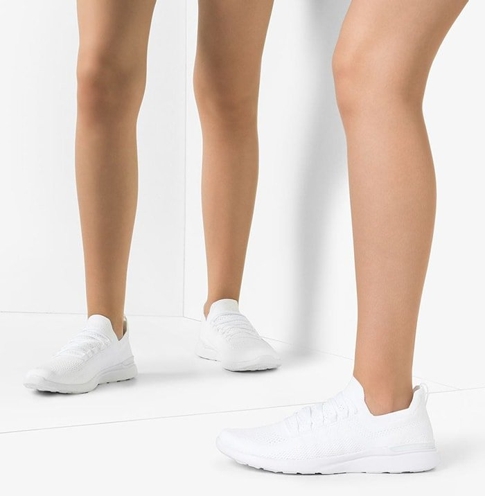 White TechLoom Breeze sneakers from APL: Athletic Propulsion Labs featuring a round toe, a pull-on style, a perforated style and a flat rubber sole
