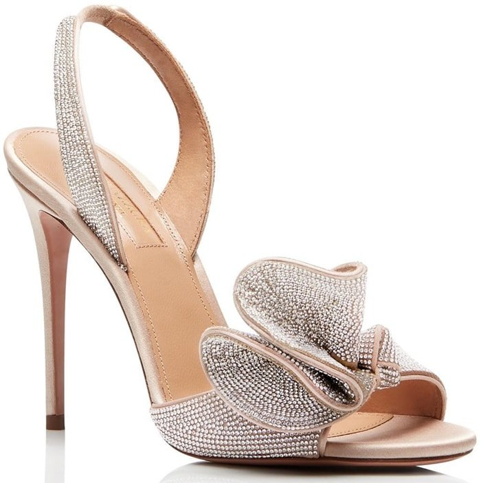 The show-stopping pair was crafted in Italy from shimmery satin in soft powder pink