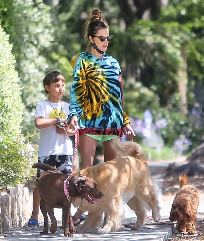 Alessandra Ambrosio wears trendy tie-dye hoodie as she walks her dogs with her son Noah