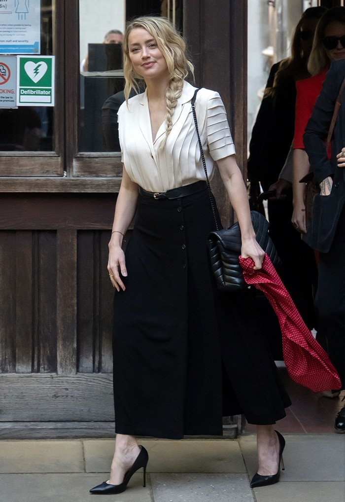 Amber Heard in a pleated white blouse with a belted maxi skirt on July 20, 2020
