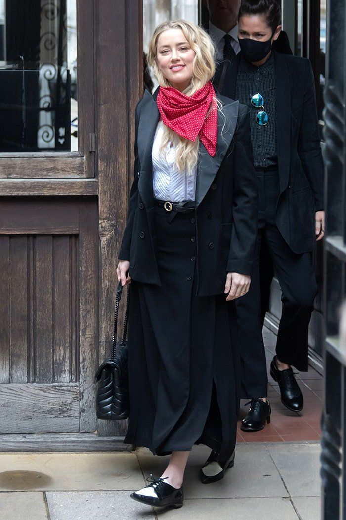 Amber Heard wears a Temperley London shirt with Joseph Maddy maxi skirt, Bella Freud jacket, and her red scarf