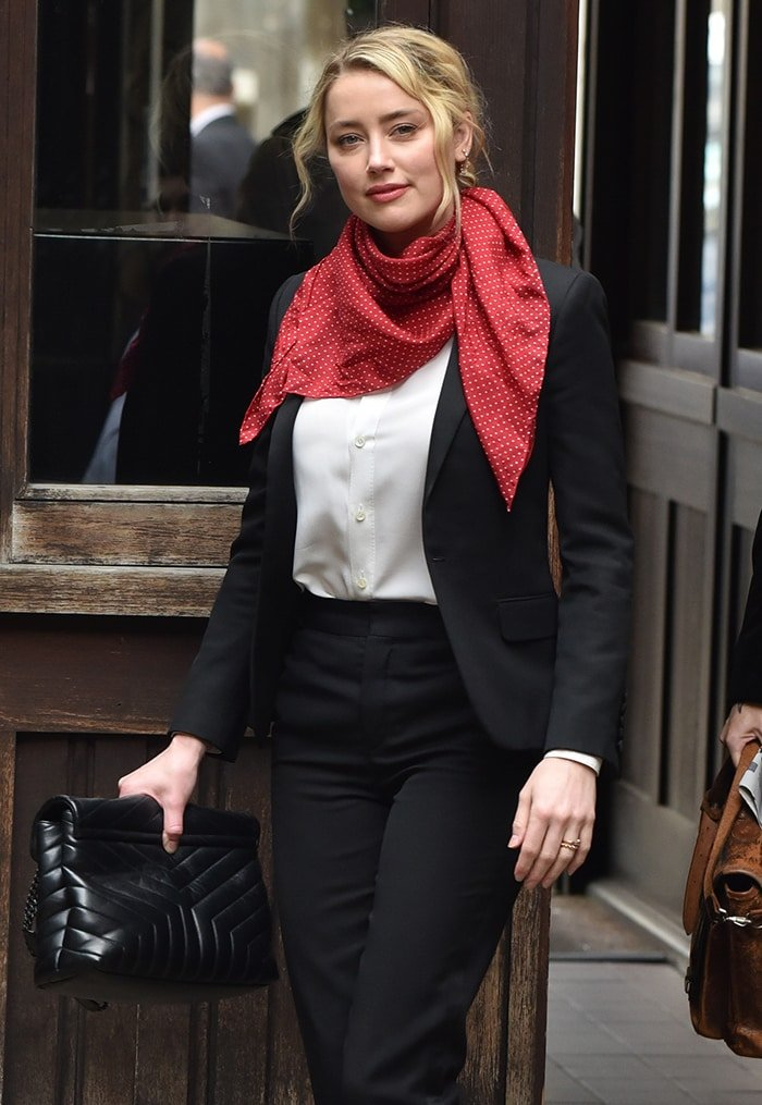 Amber Heard still wearing her trademark red polka dot scarf during the 14th trial day