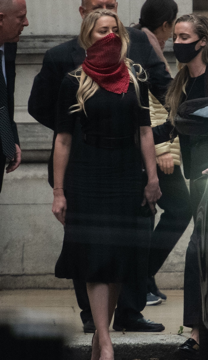 Star witness Amber Heard wears a black dress at the Royal Courts of Justice
