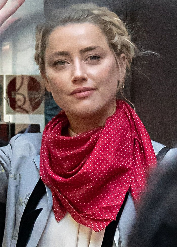 Amber Heard styles her hair in a braided updo