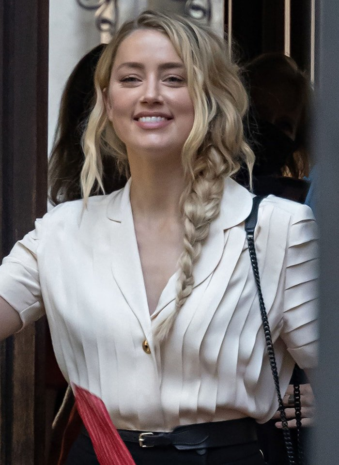 Amber Heard wears minimal makeup with braided hairstyle