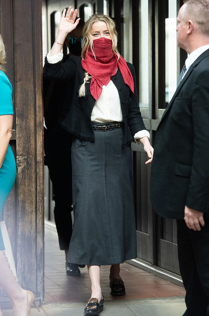 Amber Heard teams her red scarf with a white shirt, black blazer, and gray maxi skirt on July 17, 2020