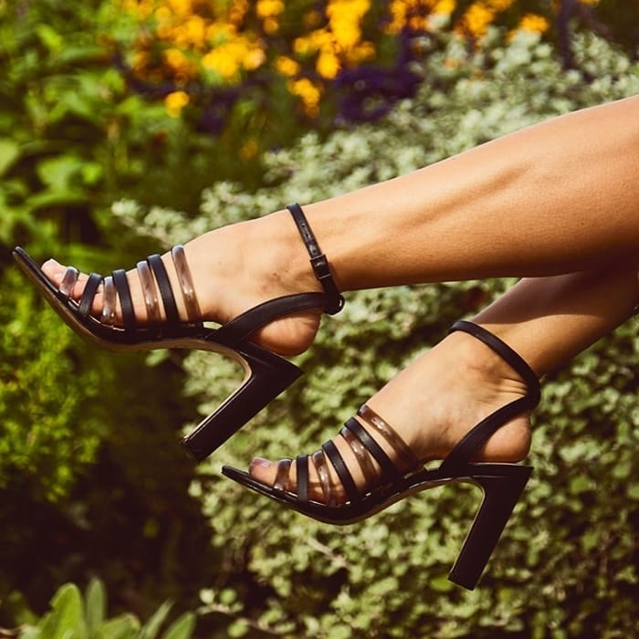 Solid and clear straps alternate down the foot of this high-heel sandal that's ready for warm sunshine and sultry night life