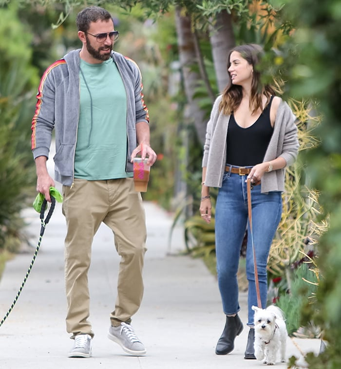 Ben Affleck wears a hooded jacket with turquoise tee and khaki pants