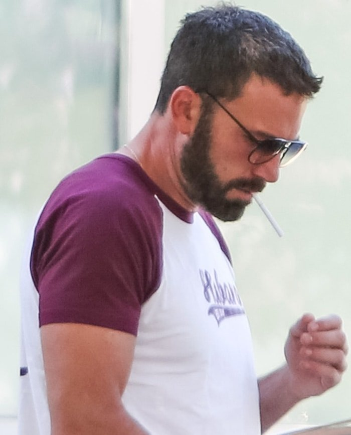 Ben Affleck apparently trying to light a cigarette with an empty hand