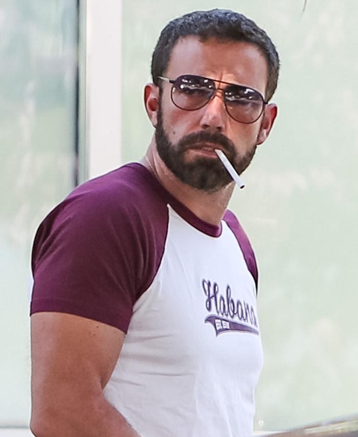 Ben Affleck takes a break to smoke a cigarette